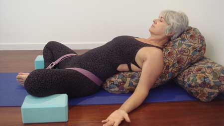 Kim Stansfield in a reclined bound angle pose