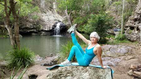 Kim Stansfield doing yoga in national park at Maleny