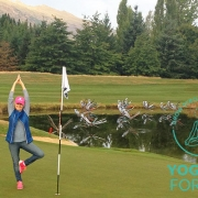 Kim Stansfield doing yoga next to a lake on a golf course