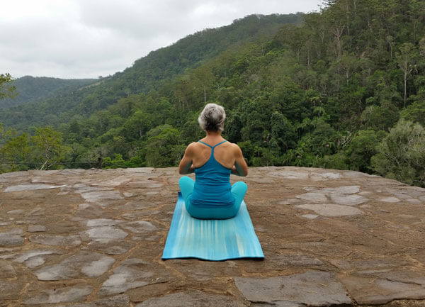 Kim Stansfield doing yoga in the mountains