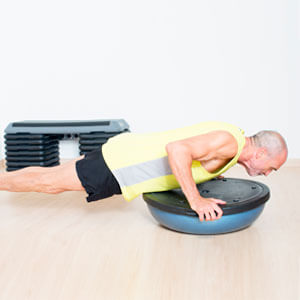 Old man doing a disk push up