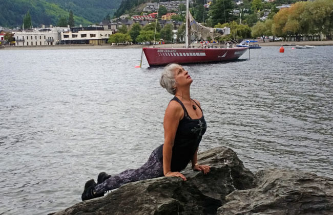 Kim Stansfield doing yoga on rocks in Queenstown