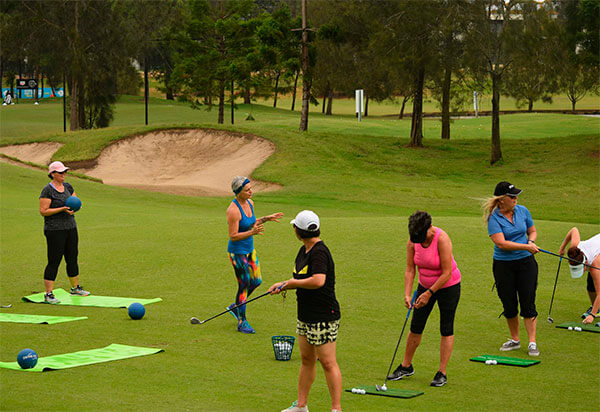 Kim Stansfield teaching a swingfit golf yoga class
