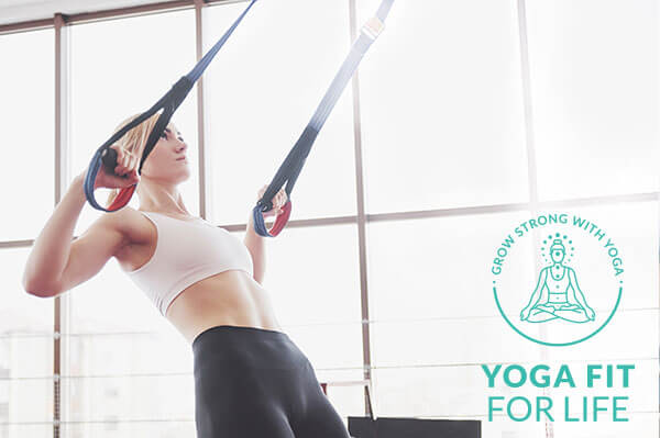 Young woman working out using resistance bands