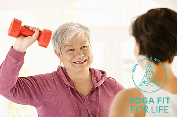 Elderly woman lifting a small weight