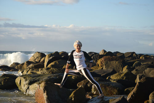 Kim Stansfield standing on rocks in Caloundra
