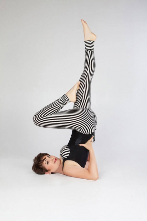 Kim Stansfield wearing a stripped outfit whilst doing yoga
